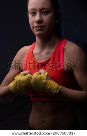 Vrouwelijke vechtsporten vechter vuist witte sport Stockfoto © wavebreak_media