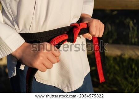 Karateka fastening his belt Stock photo © Talanis