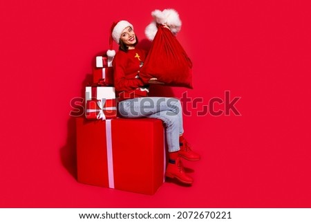 Beautiful santa claus girl. Gift bags choice. Stock photo © bogumil