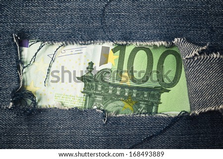 hundred euros bill through torn blue jeans texture stock photo © stevanovicigor