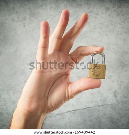hand holding padlock with european union euro currency symbol stock photo © stevanovicigor