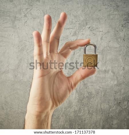 hand holding padlock with copyright symbol stock photo © stevanovicigor