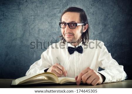 Nerd poet writing poems Stock photo © stevanovicigor