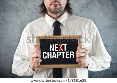 Businessman holding blackboard with NEXT CHAPTER title Stock photo © stevanovicigor