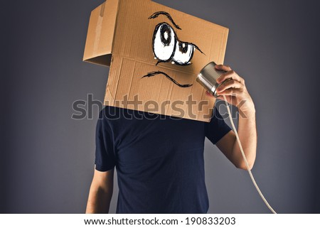 Man with cardboard box on his head using tin can telephone Stock photo © stevanovicigor