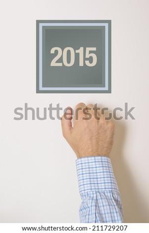 Businessman knocking on door with number 2015 Stock photo © stevanovicigor