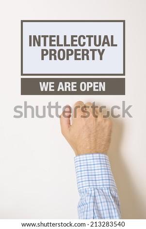 businessman knocking on intellectual property office door stock photo © stevanovicigor