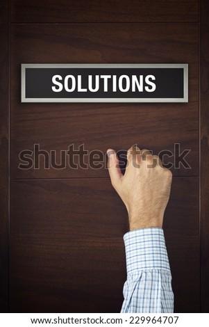 Hand is knocking on Solutions bureau door Stock photo © stevanovicigor