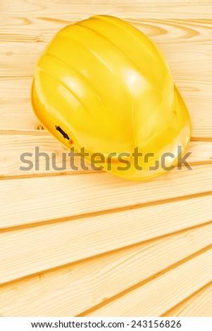 Yellow hardhat on pine wood planks Stock photo © stevanovicigor