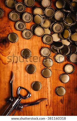 classic bottle opener and pile of beer bottle caps stock photo © stevanovicigor