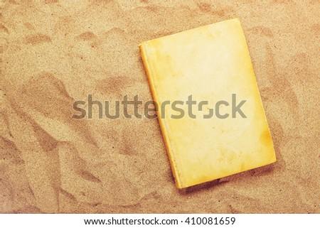 Reading favourite classic old book on summer vacation beach holi Stock photo © stevanovicigor