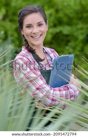 Stock photo: Confident doctor posing in a hemp field