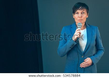 Elegant female television journalist doing business reportage Stock photo © stevanovicigor