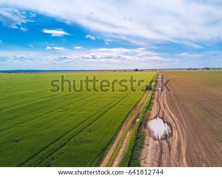 Tractor on country road through wheat field, drone pov Stock photo © stevanovicigor