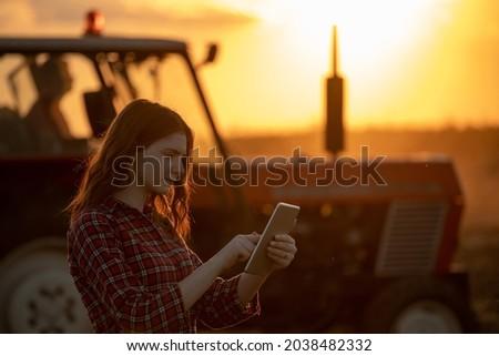 Sunset silhouette of female farmer writing notes in field Stock photo © stevanovicigor