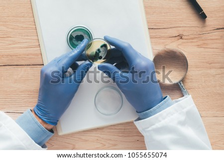 Overhead view of laboratory technician analyzing petri dish bact Stock photo © stevanovicigor