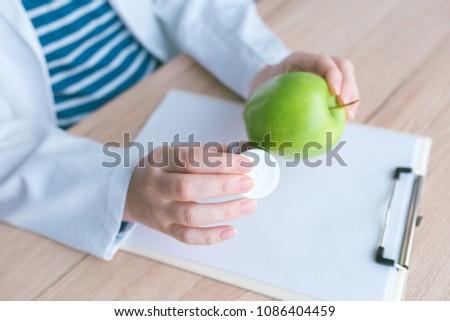 doctor advising apple instead of pills and antibiotics stock photo © stevanovicigor