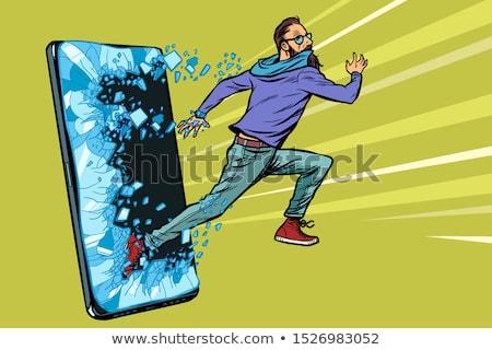 hipster man running Phone gadget smartphone. Online Internet application service program Stock photo © studiostoks