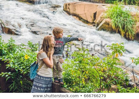 Mãe filho belo cachoeira cidade mulher Foto stock © galitskaya