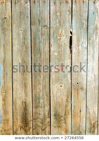 Old wooden boat hull with decayed wood, peeling paint Stock photo © tilo
