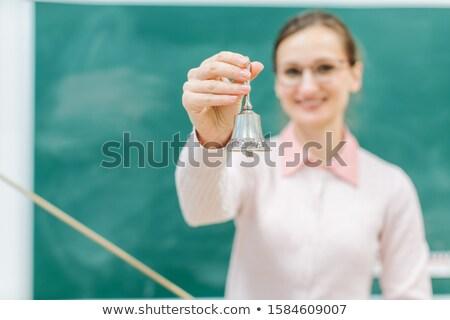 Teacher ringing the bell for class to begin Stock photo © Kzenon