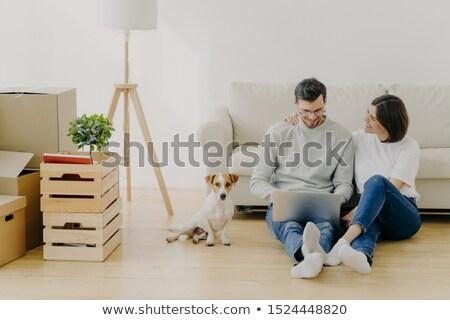 Férj feleség ül új lakás laptop számítógép Stock fotó © vkstudio