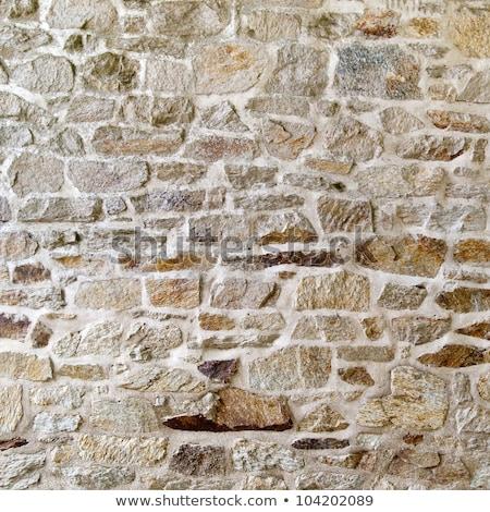 Eski yıpranmış dengesiz taş duvar doku arka plan Stok fotoğraf © grafvision