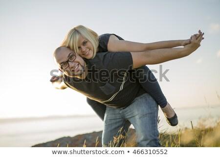 Beautiful Couple At The Sunset Habing Fun On Seaside Foto stock © Lopolo