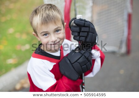 Portrait Of Happy Child Play Hockey Outside Foto stock © Lopolo