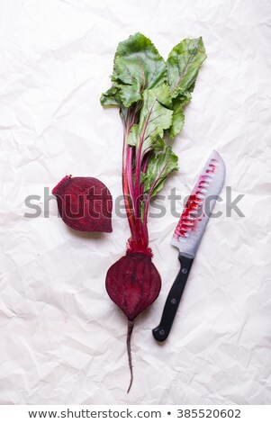 Farmer cutting beet tops stock photo © rcarner