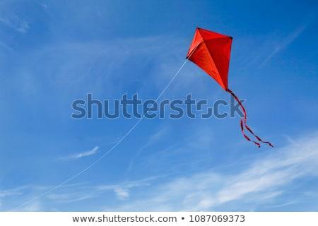 piros · papírsárkány · repülés · madár · kék · toll - stock fotó © ansonstock