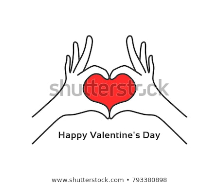 Red heart in male and female hands stock photo © alrisha