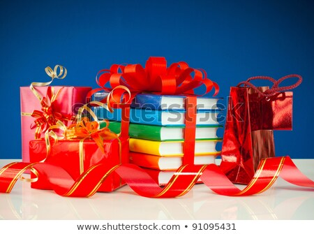 Christmas presents with stack of books against blue background Stock photo © AndreyKr