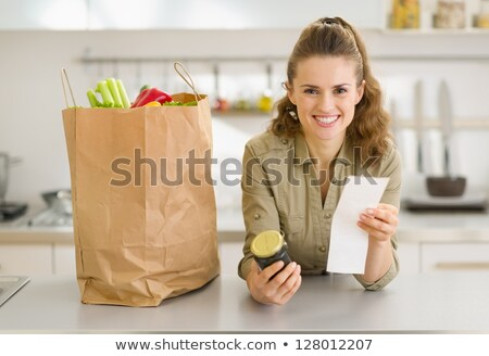 Young woman at home examining shopping bags Stock photo © photography33