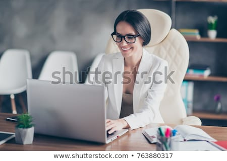 young attractive business woman with glasses stock photo © dash