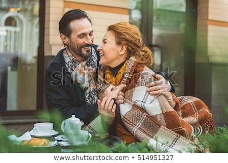 A smiling middle aged woman looking at us. Stock photo © photography33