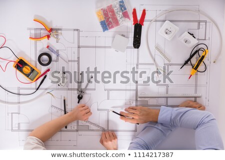 female electrician holding a measurement tool stock photo © photography33