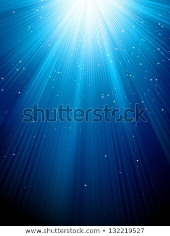 Stock photo: Snow and stars on blue luminous rays. EPS 8