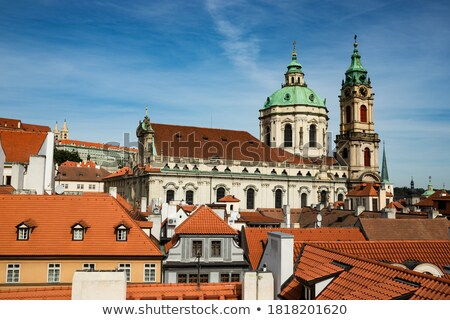 Prague summer gardens and Church of Saint Nicholas Stock photo © tannjuska