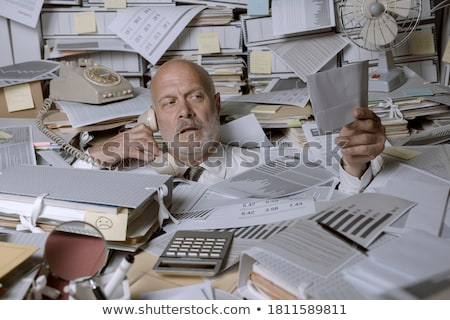 Overwhelmed businessman answering telephones Stock photo © photography33