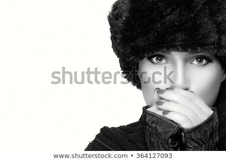 beautiful woman in white fur hat stock photo © pilgrimego