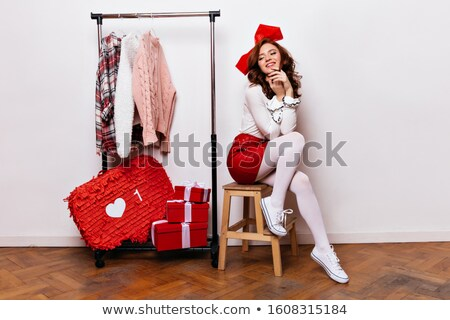Pretty young woman dressed in party wear attire Stock photo © stockyimages