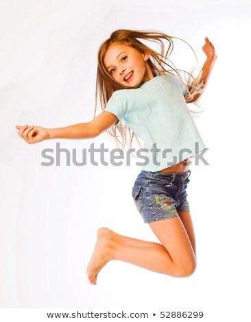 Young blonde girl jumping Stock photo © dashapetrenko