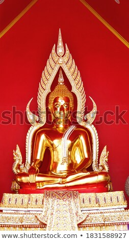 buddha sculpture in front of the golden temple stock photo © bbbar