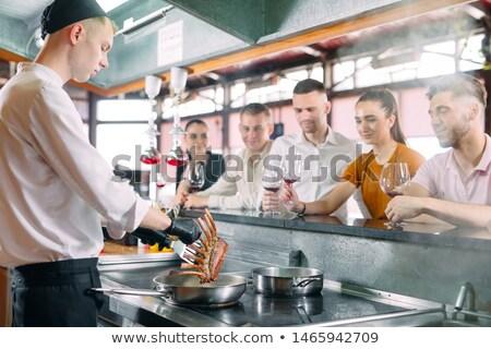 Invitado restaurante dieta azul camisa blanco Foto stock © pzaxe