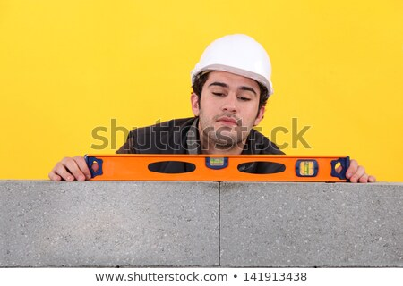 Stonemason using a bubble level Stock photo © photography33