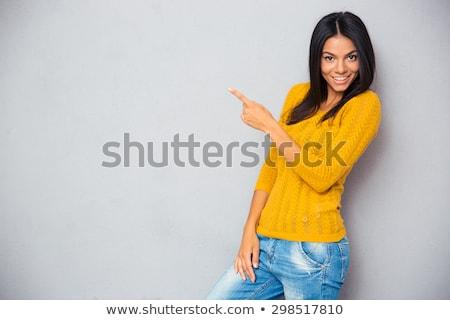 jovem · morena · indicação · câmera · alegre · foco - foto stock © stockyimages