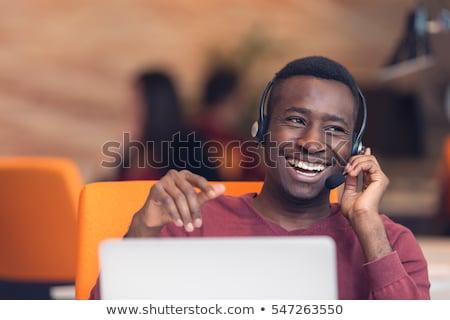 Séduisant accueillant service clients représentant homme regarder Photo stock © wavebreak_media