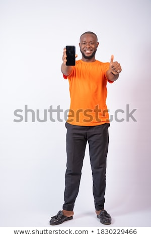 Man approving with his thumbs up against white background Stock photo © wavebreak_media