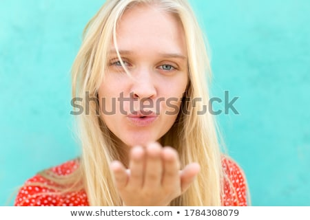 Portrait of a happy woman blowing a kiss against a white background Stock photo © wavebreak_media